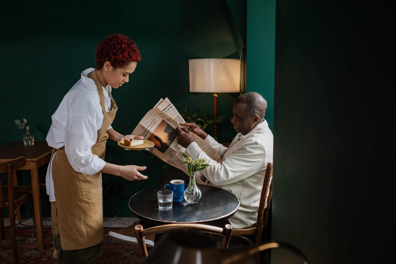waitress serves customer at restaurant